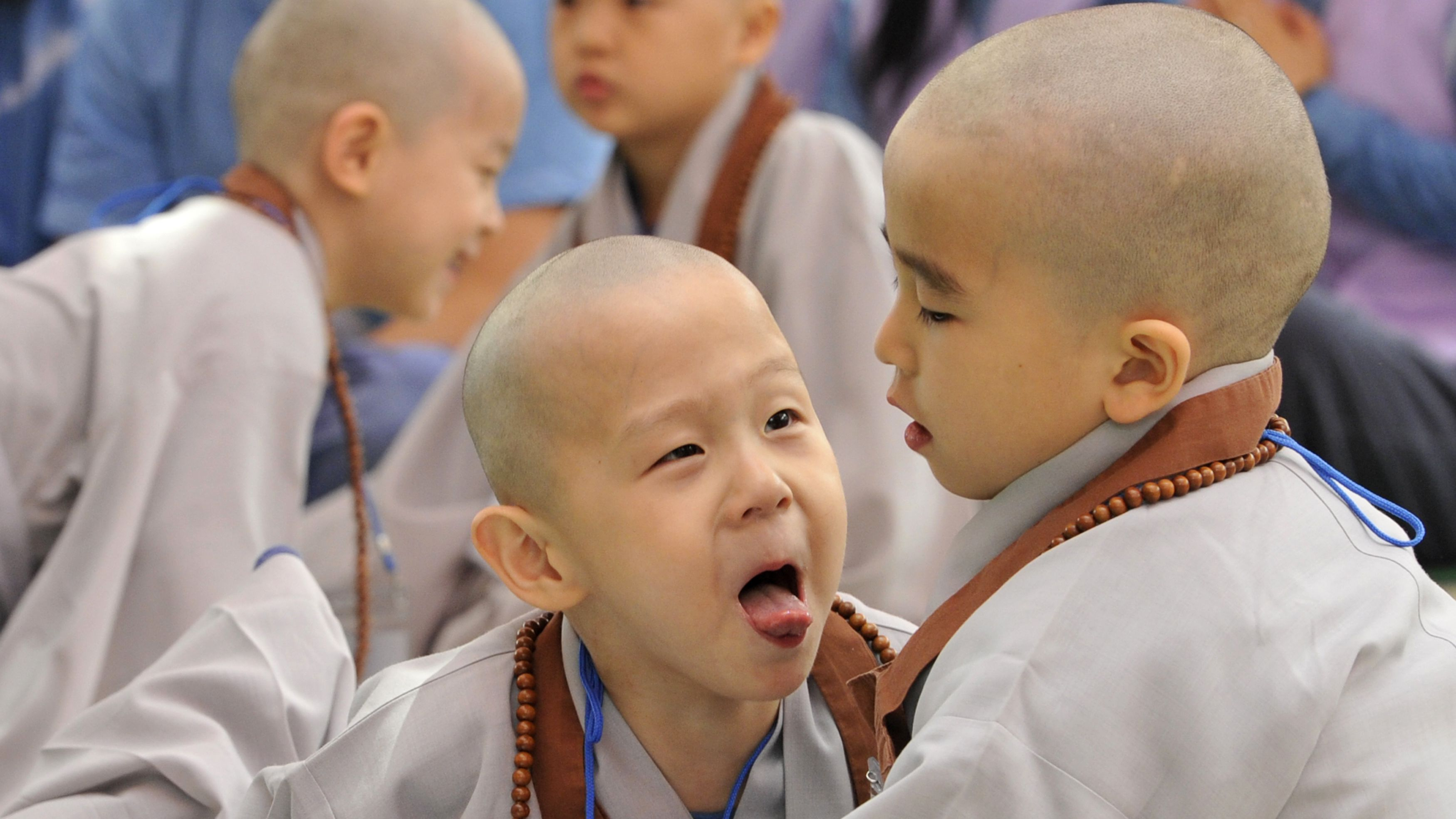 Monk child friends smiling