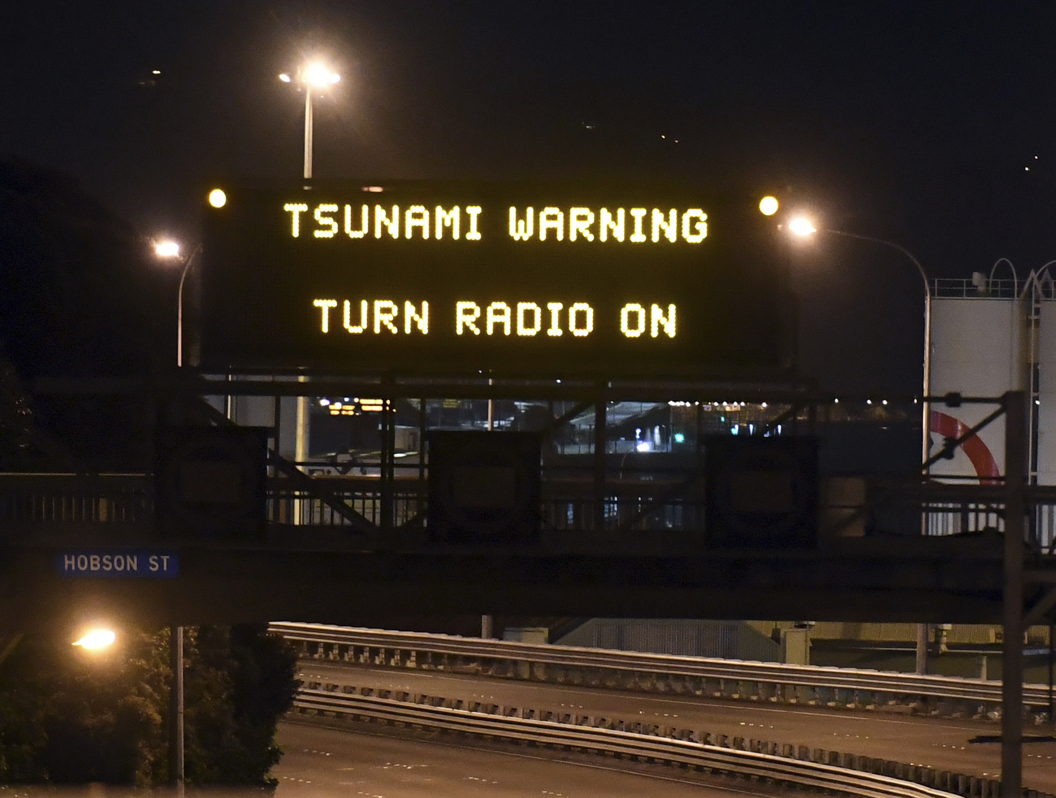 Motorway sign warning of Tsunami, in Wellington, Monday, Nov. 14, 2016, after a major earthquake struck New Zealand's south Island early Monday. A powerful earthquake struck in a mostly rural area close to the city of Christchurch but appeared to be more strongly felt in the capital, Wellington, more than 200 Km (120 miles) away.
