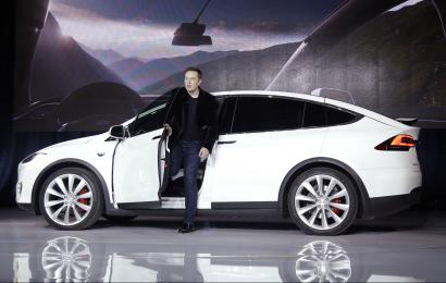 In this Sept. 29, 2015, file photo, Elon Musk, CEO of Tesla Motors Inc., introduces the Model X car at the company's headquarters in Fremont, Calif. Tesla Motors customers will get enhanced radar and other features in an over-the-air software update that starts Wednesday, Sept. 21, 2016. The update makes the Model S sedan and Model X SUV more reliant on radar than cameras when driving in Tesla's semi-autonomous Autopilot mode. Teslas made after October 2014 have radar.