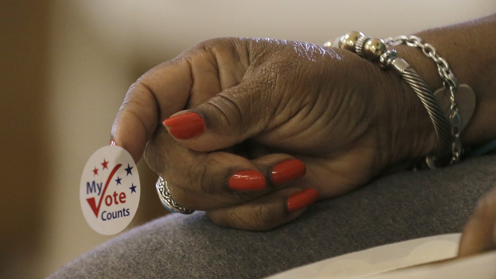 A worker holds stickers for voters at a polling station at the Princeton Baptist Church during the U.S. presidential election, in Princeton, North Carolina, U.S. November 8, 2016. REUTERS/Chris Keane - RTX2SLJ6