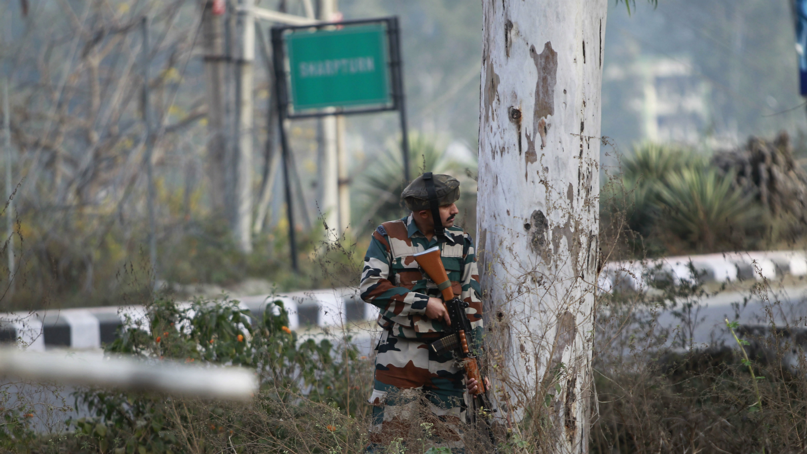 An Indian soldier takes position outside an army camp at Nagrota, in the outskirts of Jammu, India, Tuesday, Nov. 29, 2016. Police said that militants fired indiscriminately and tried to enter an army camp in Nagrota town, triggering a fierce gun battle.