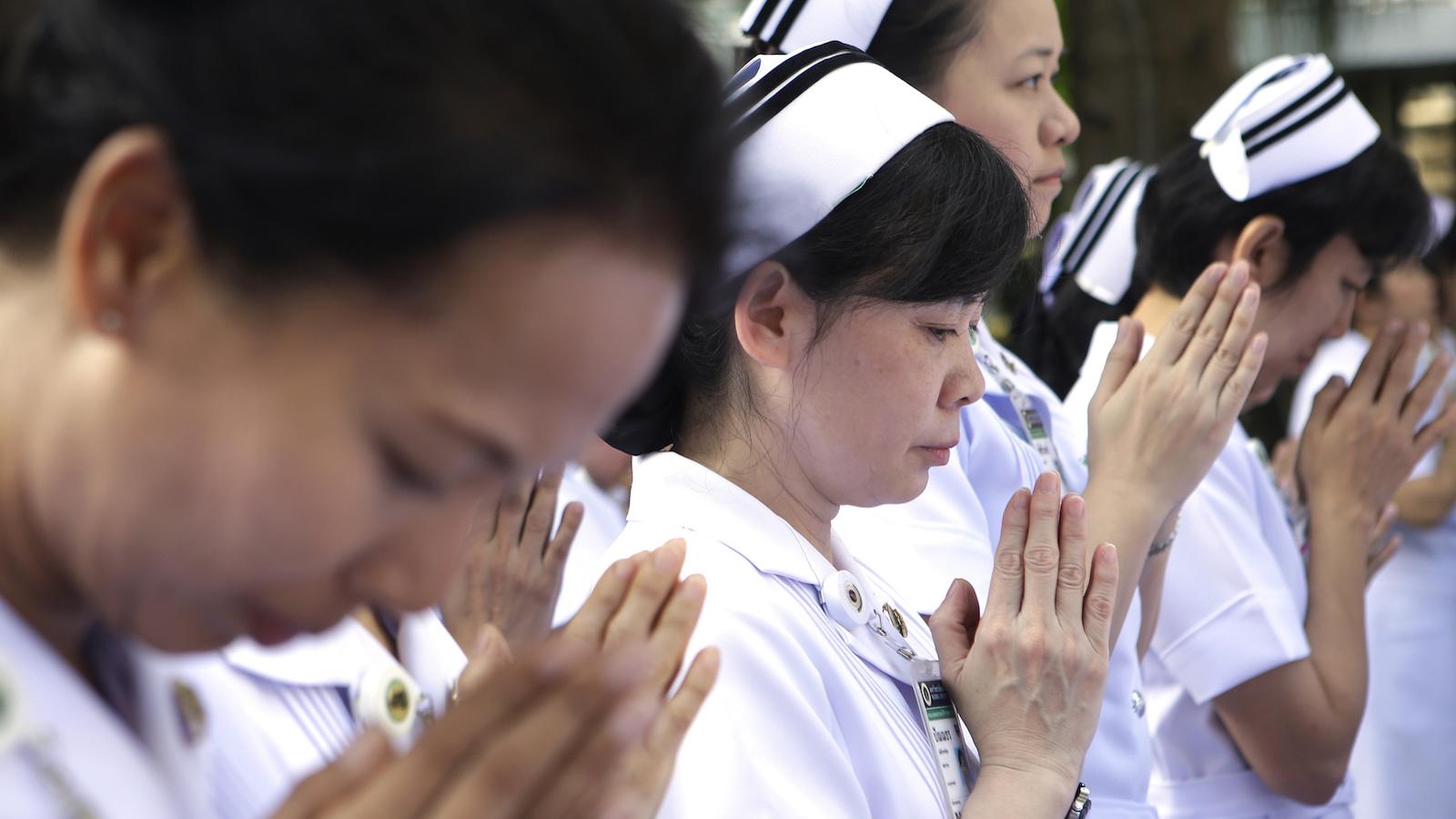 Nurses pray in Thailand