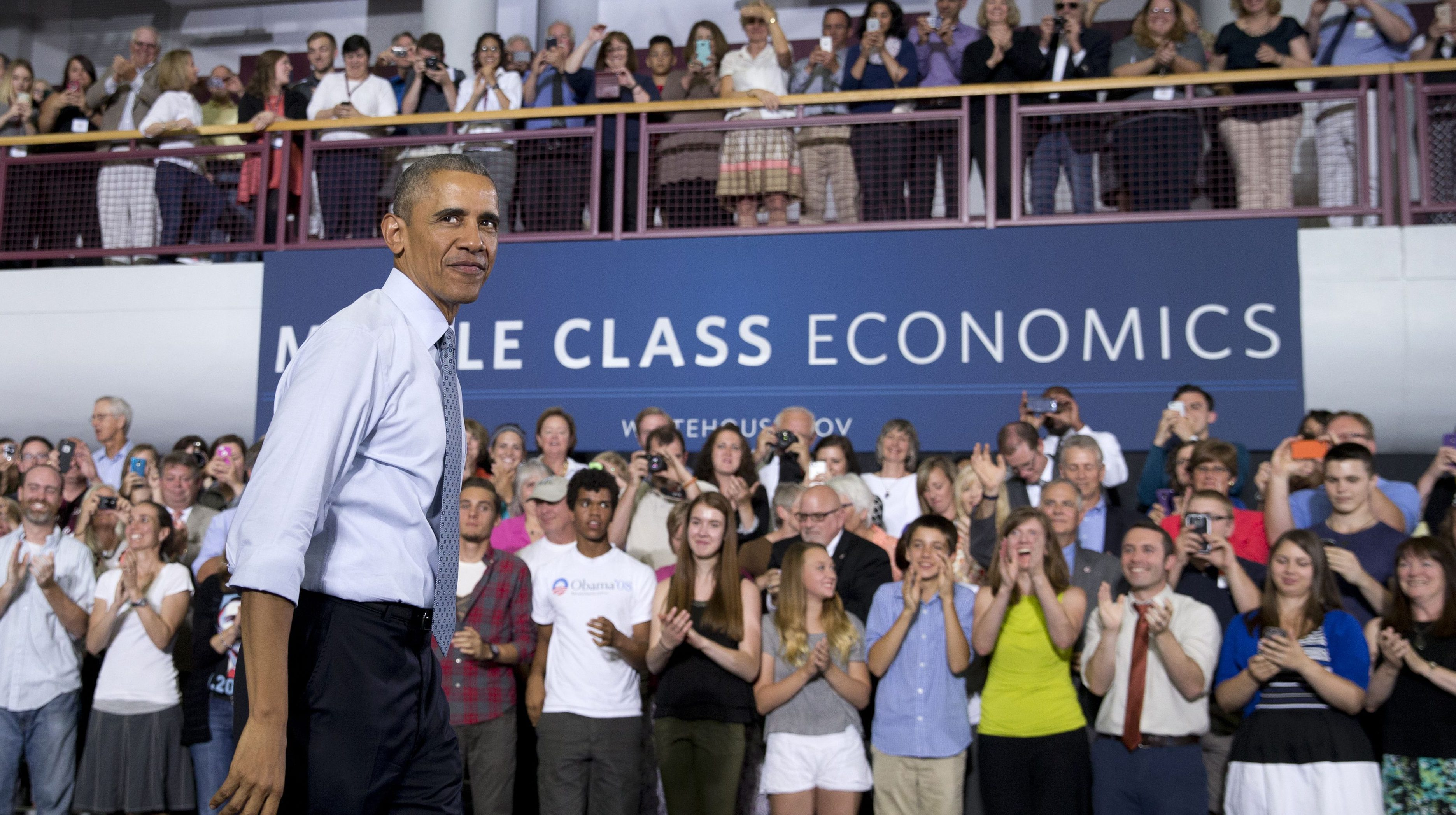 President Barack Obama looks out over the audience after speaking at the University of Wisconsin at La Crosse, in La Crosse, Wis., Thursday, July 2, 2015, about the economy and to promote a proposed Labor Department rule that would make more workers eligible for overtime.