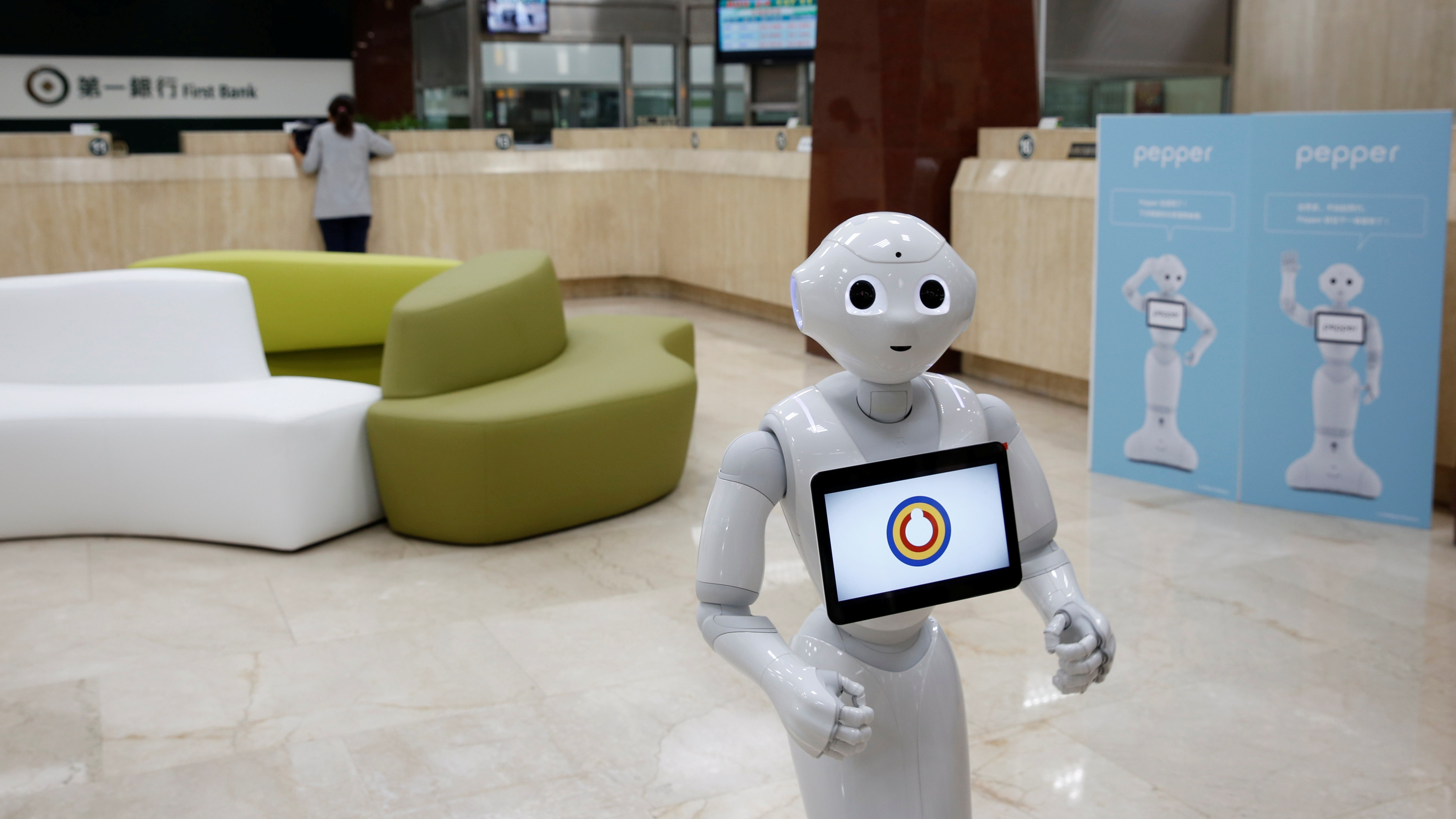 SoftBank's robot 'Pepper', is seen at First Bank branch as a concierge to welcome customers in Taipei,...