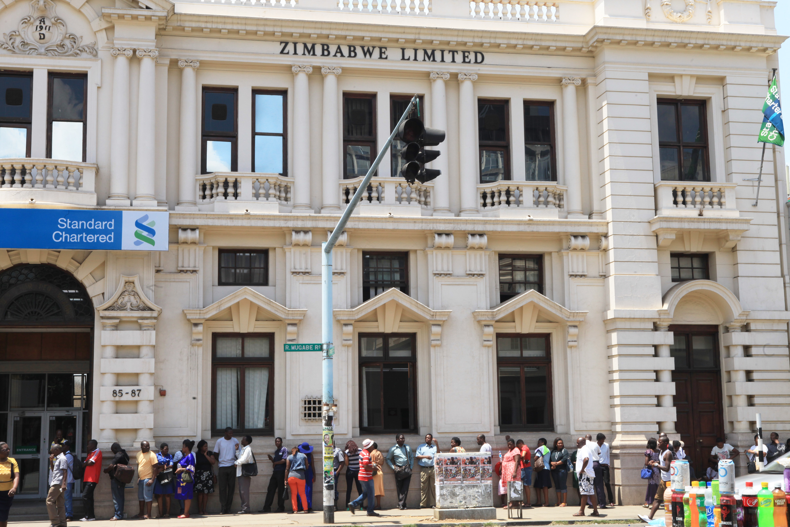 Zimbabwean queue outside Standard Charted Bank in Harare, Tuesday , November, 8, 2016.