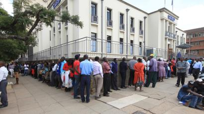 Severe cash shortage and panic over bond notes as replacement currency sees Zimbabwean line up for cash