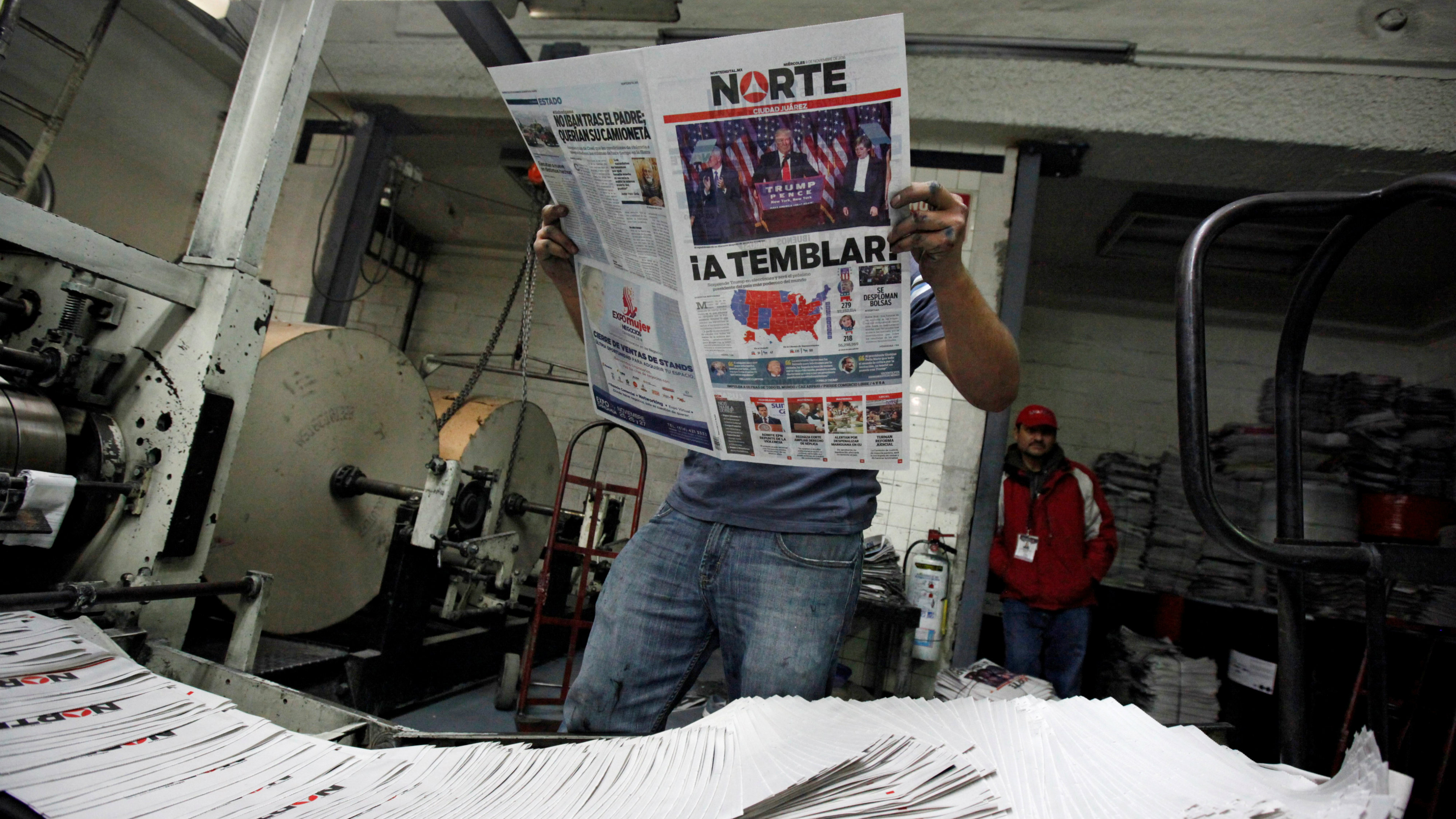 "A worker reads a freshly printed newspaper with the headline reading ""We will tremble"" at a printer of the local daily Norte in Ciudad Juarez, Mexico, November 9, 2016."