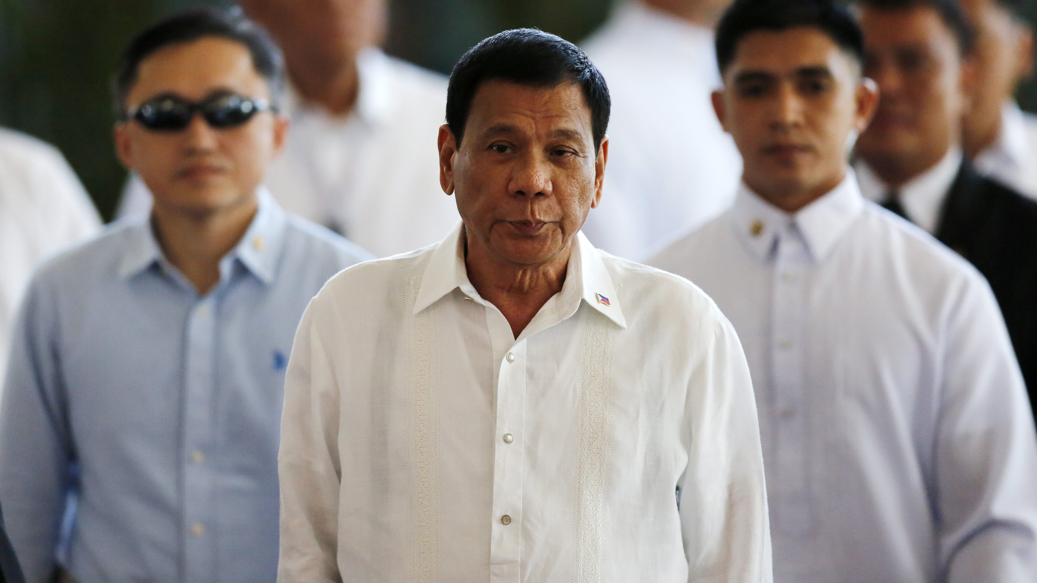 Filipino President Rodrigo Duterte is escorted during a departure ceremony at Manila's international airport, Philippines, 25 October 2016. Duterte leaves for Japan to meet Prime Minister Shinzo Abe. The two are expected to agree on expanding bilateral ties in areas of maritime security and defense cooperation, according to news reports.