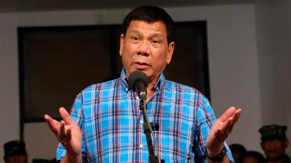 Philippine President Rodrigo Duterte gestures during a briefing with the military after his visit at Camp General Basilio Navarro in Zamboanga City, Philippines November 25, 2016.
