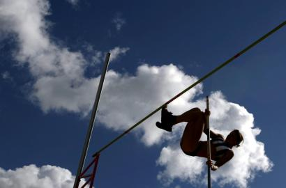 silhouette of a woman pole vaulting