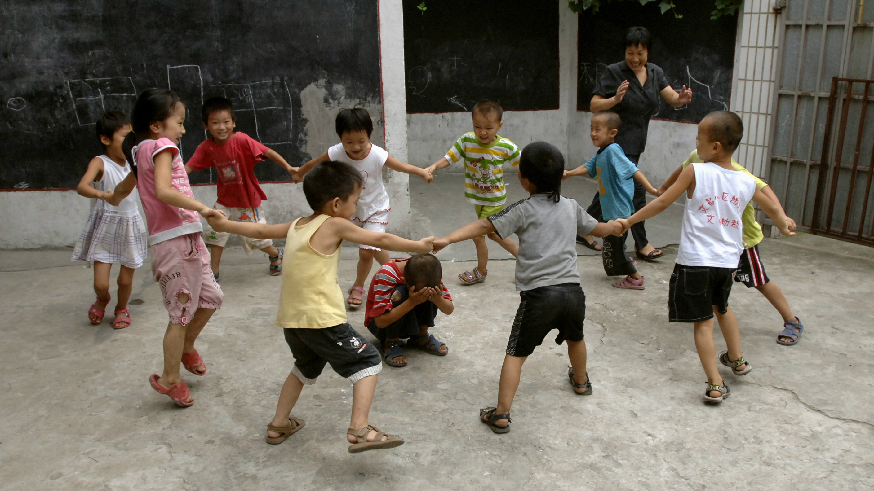 Students play a game inside a primary school on the first day of their new semester in Hefei in east...