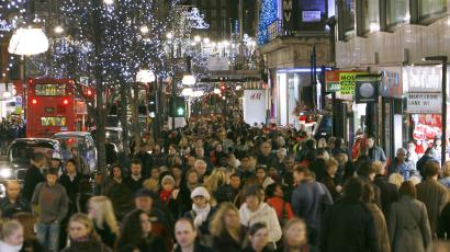 Shoppers walk past shops on the last weekend before Christmas in Oxford Street, central London.