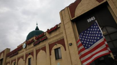 An American flag hangs on a car outside the American Muslim Society mosque in Detroit, Michigan