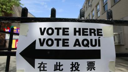 A sign is seen outside a polling place in Brooklyn, New York April 24, 2012. Mitt Romney's expected wins in five states that hold primary votes on Tuesday will earn him scores of delegates on his way to becoming the Republican presidential nominee and allow him to concentrate on a general election campaign against President Barack Obama. New York, Connecticut, Delaware, Rhode Island and Pennsylvania are holding republican presidential primaries April 24.