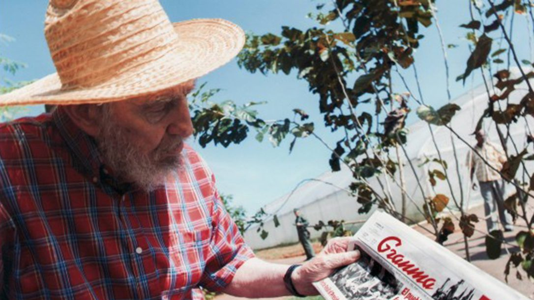 Former Cuban leader Fidel Castro shows a copy of the October 19, 2012.