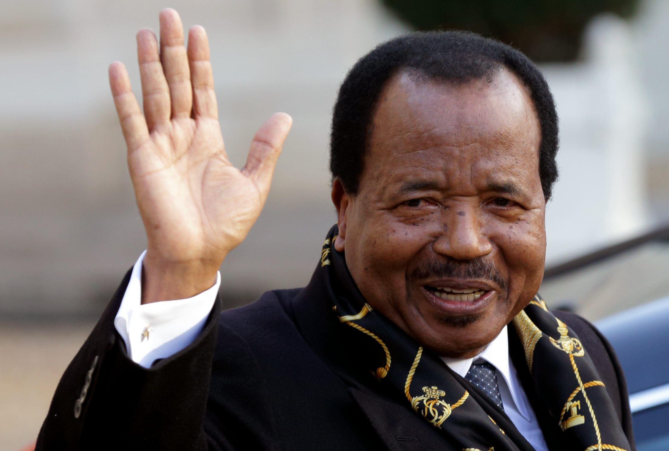 Cameroon's President Paul Biya waves as he leaves following a meeting at the Elysee Palace in Paris, January 30, 2013.