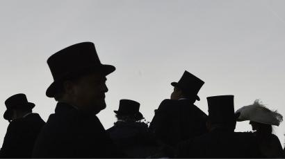 Silhouette of people wearing top hats