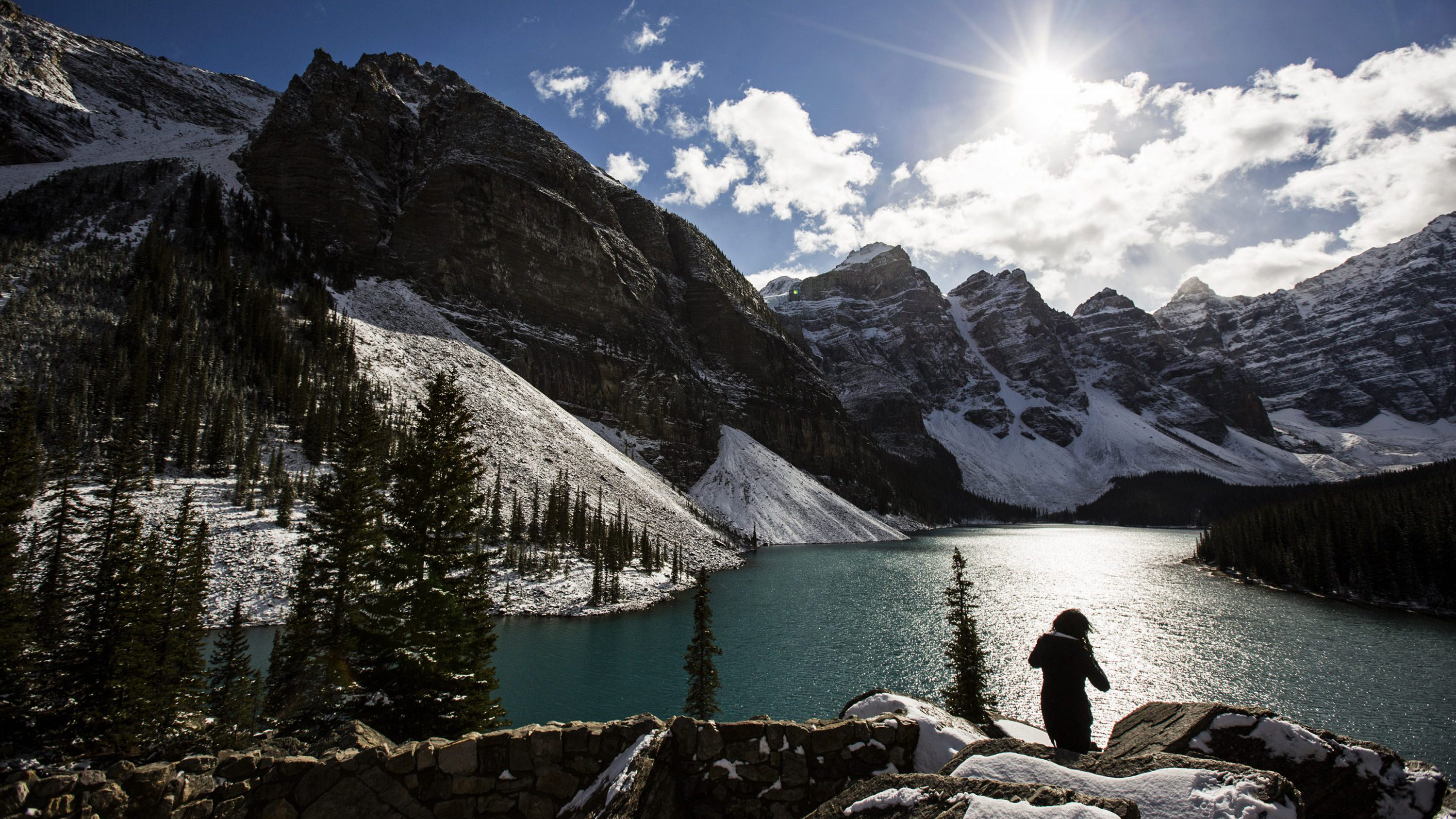A woman looks over Moraine Lake in Banff National Park, in the Canadian Rocky Mountains outside the village of Lake Louise, Alberta, October 2, 2014.