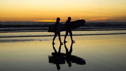 Surfers on the beach in California