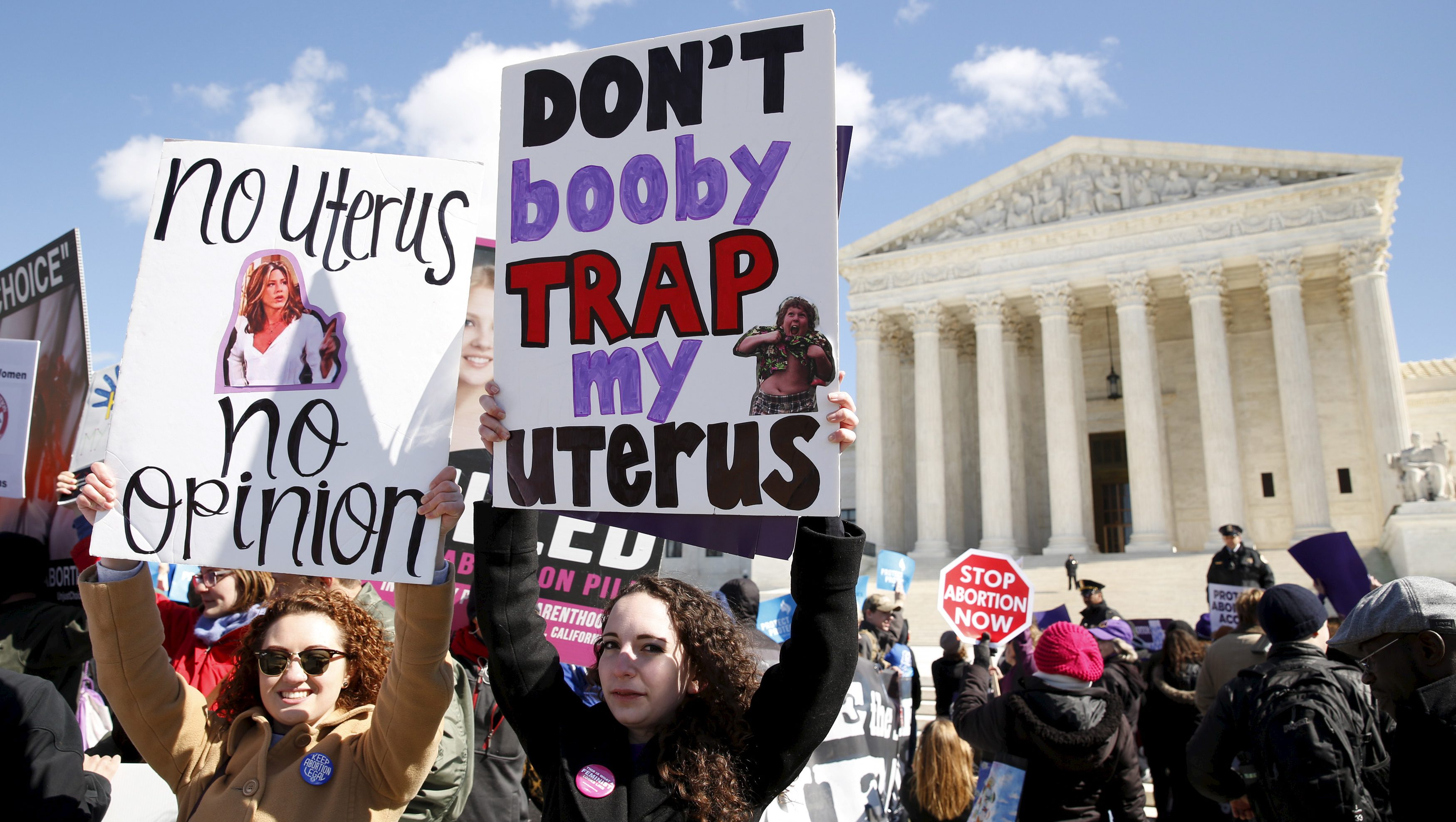 Protesters demonstrate in front of the U.S. Supreme Court on the morning that the court took up a major abortion case focusing on whether a Texas law that imposes strict regulations on abortion doctors and clinic buildings interferes with the constitutional right of a woman to end her pregnancy in Washington March 2, 2016.  REUTERS/Kevin Lamarque  - RTS8ZI2