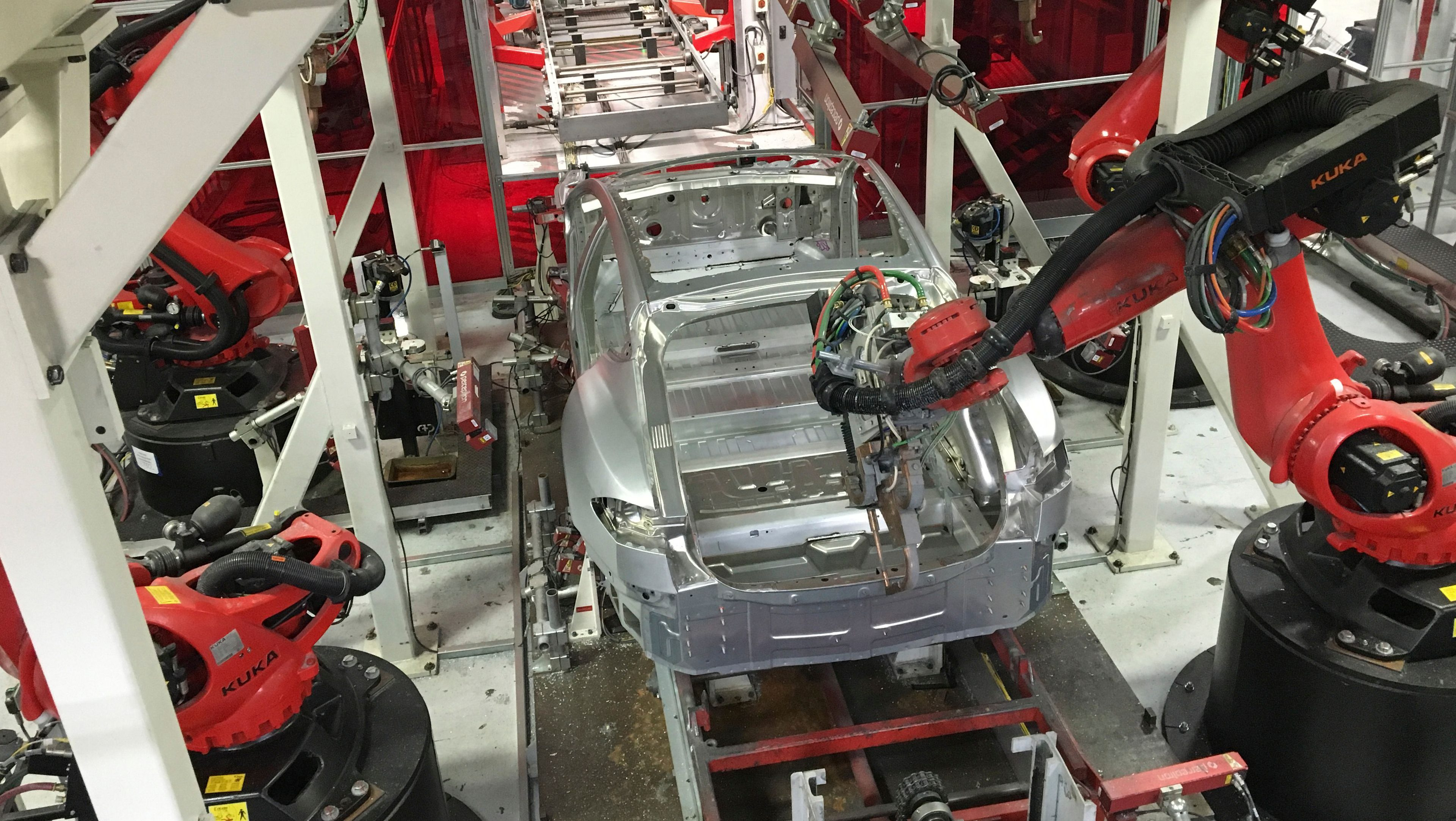 Tesla vehicles are being assembled by robots at Tesla Motors Inc factory in Fremont