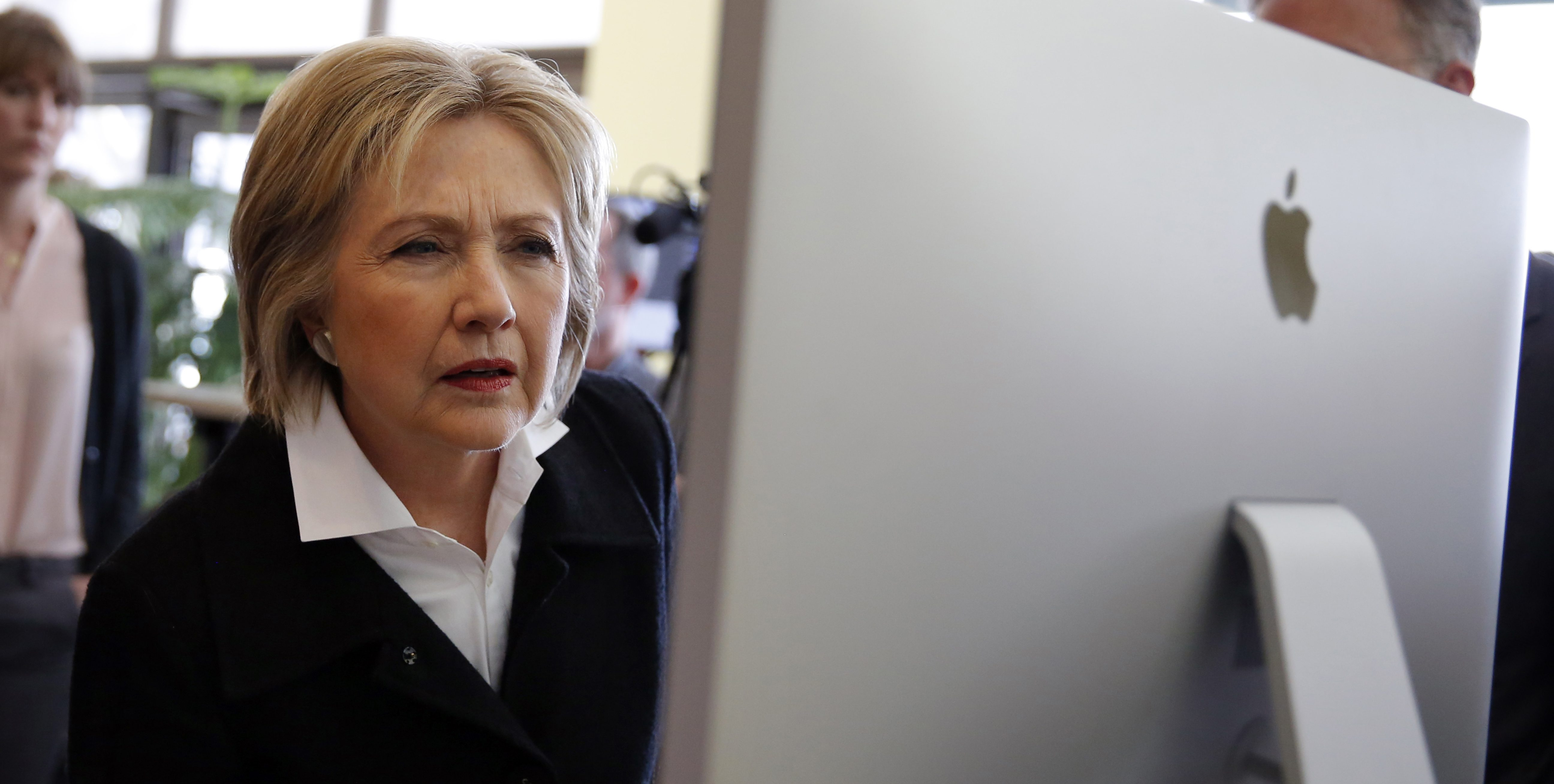U.S. Democratic presidential candidate Hillary Clinton looks at a computer screen during a campaign stop at Atomic Object company in Grand Rapids, Michigan, U.S. March 7, 2016. REUTERS/Carlos Barria/File Photo - RTSKBLY