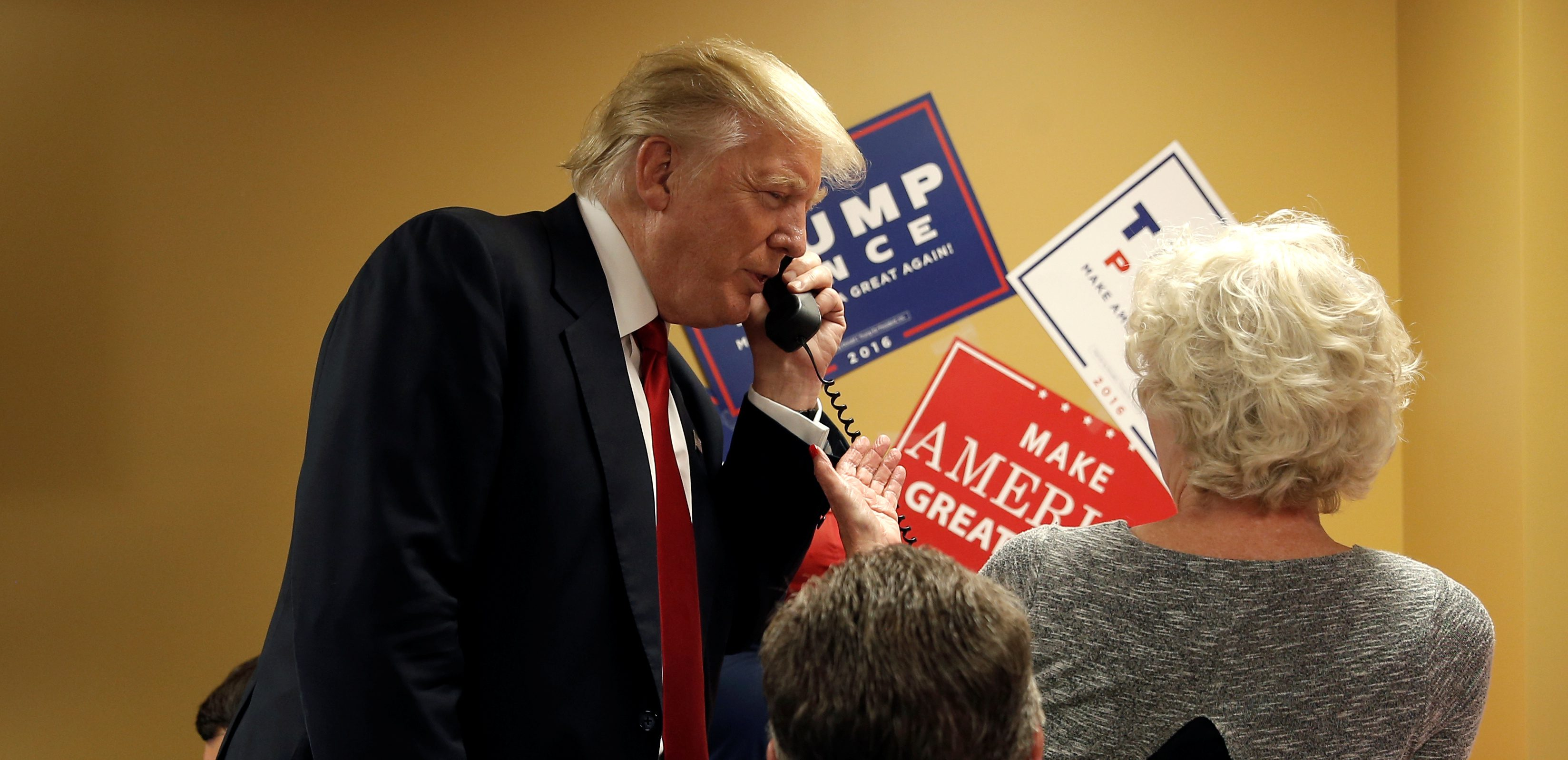 Republican presidential nominee Donald Trump talks on the phone during a visit to a Trump campaign call center in Asheville, North Carolina, U.S., September 12, 2016.  REUTERS/Mike Segar - RTSNFU8