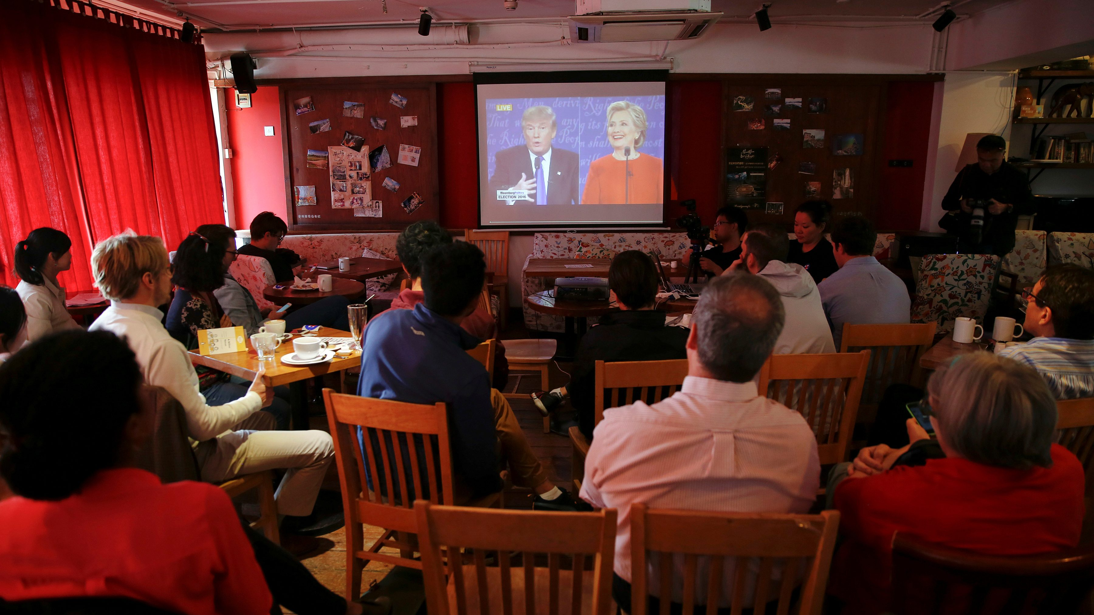 People watch a direct broadcast of the first U.S. presidential debate between Republican U.S. presidential nominee Donald Trump and Democratic U.S. presidential nominee Hillary Clinton at a cafe in Beijing