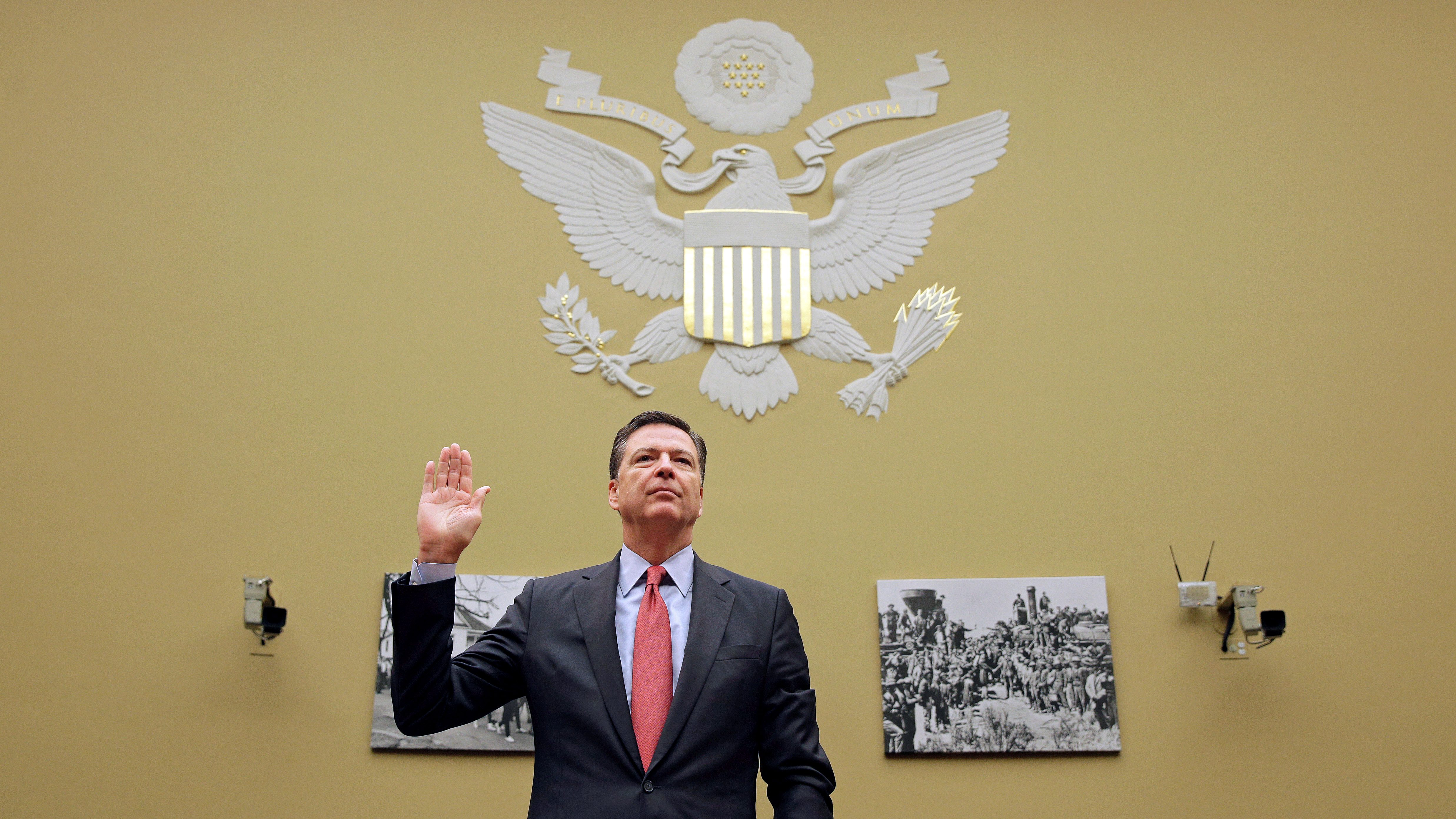 """FBI Director Comey is sworn in before testifying before a House Judiciary Committee hearing on """"Oversight of the Federal Bureau of Investigation"""" on Capitol Hill in Washington"""