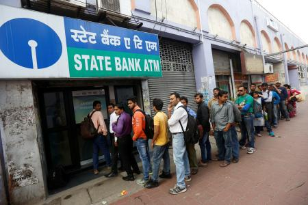 People queue outside an ATM of State Bank of India.
