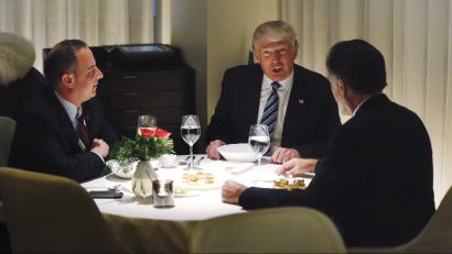 U.S. President-elect Donald Trump sits at a table for dinner with former Massachusetts Governor Mitt Romney (R) and his choice for White House Chief of Staff Reince Priebus (L) at Jean-Georges at the Trump International Hotel & Tower in New York, U.S., November 29, 2016.