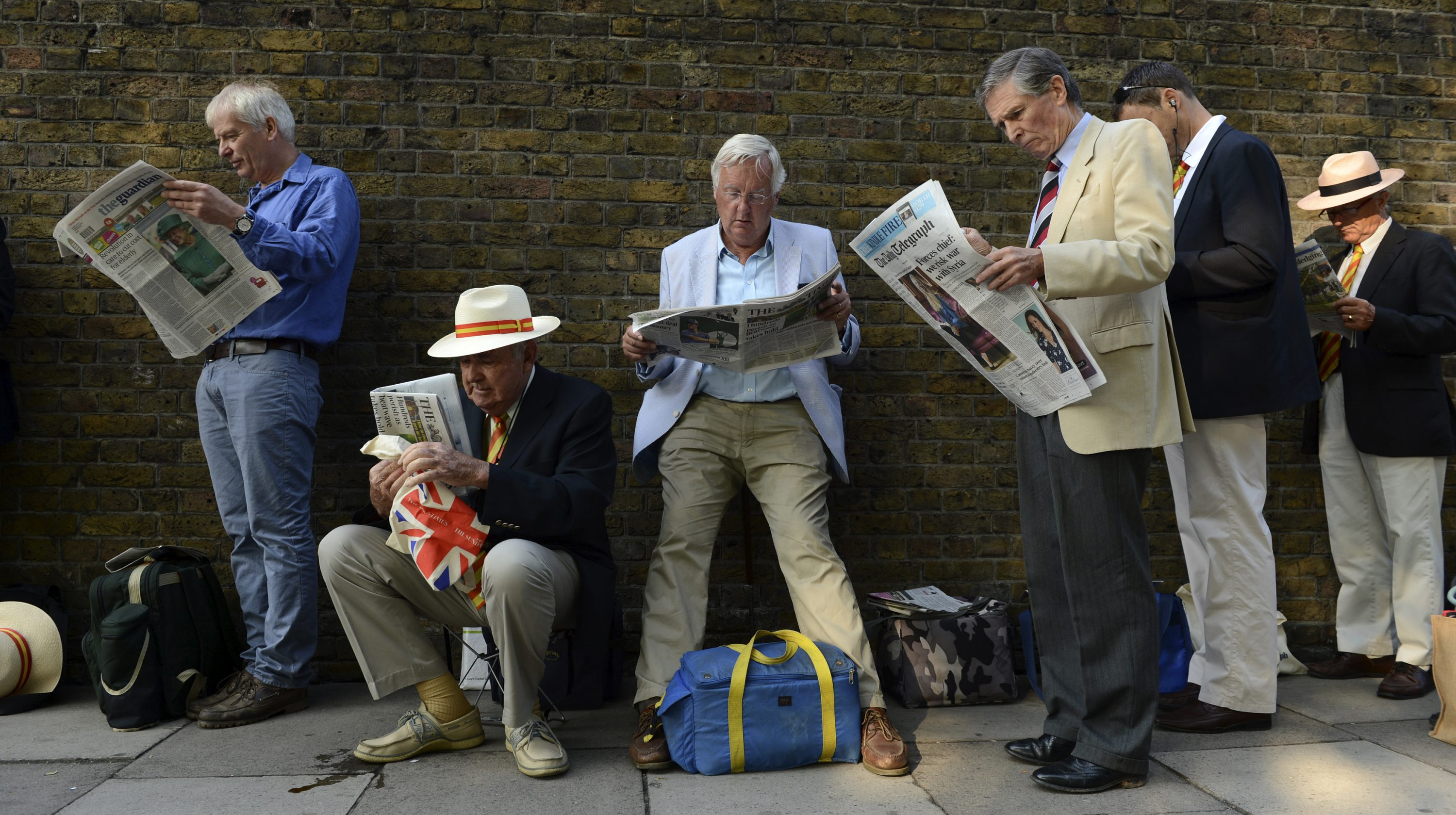 men reading the newspaper