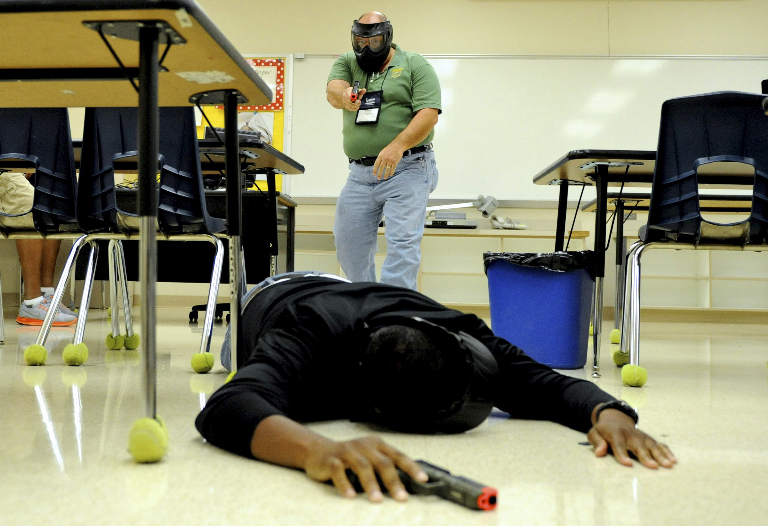 "School resource officers take part in an ""active shooter"" training exercise at Freedom Middle School during the annual National Association of School Resource Officers conference in Orlando, Florida July 18, 2013."