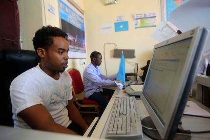 An internet cafe manager uses a computer in an internet cafe in the Hodan area of Mogadishu October 9, 2013.