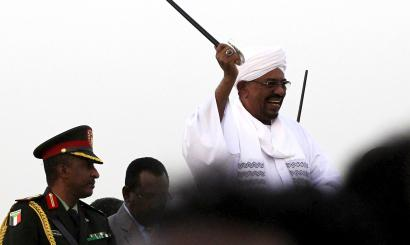 "Sudanese President Omar al-Bashir (C) waves to his supporters at the airport in the capital Khartoum, Sudan, June 15, 2015, on arrival after attending an African Union conference in Johannesburg South Africa. Al-Bashir flew out of South Africa on Monday in defiance of a Pretoria court that later said he should have been arrested to face genocide charges at the International Criminal Court. Despite a legal order for him to stay in the country ahead of the ruling on his detention, the government let Bashir leave unhindered, with South Africa's ruling party accusing the ICC of being biased against Africans and ""no longer useful""."