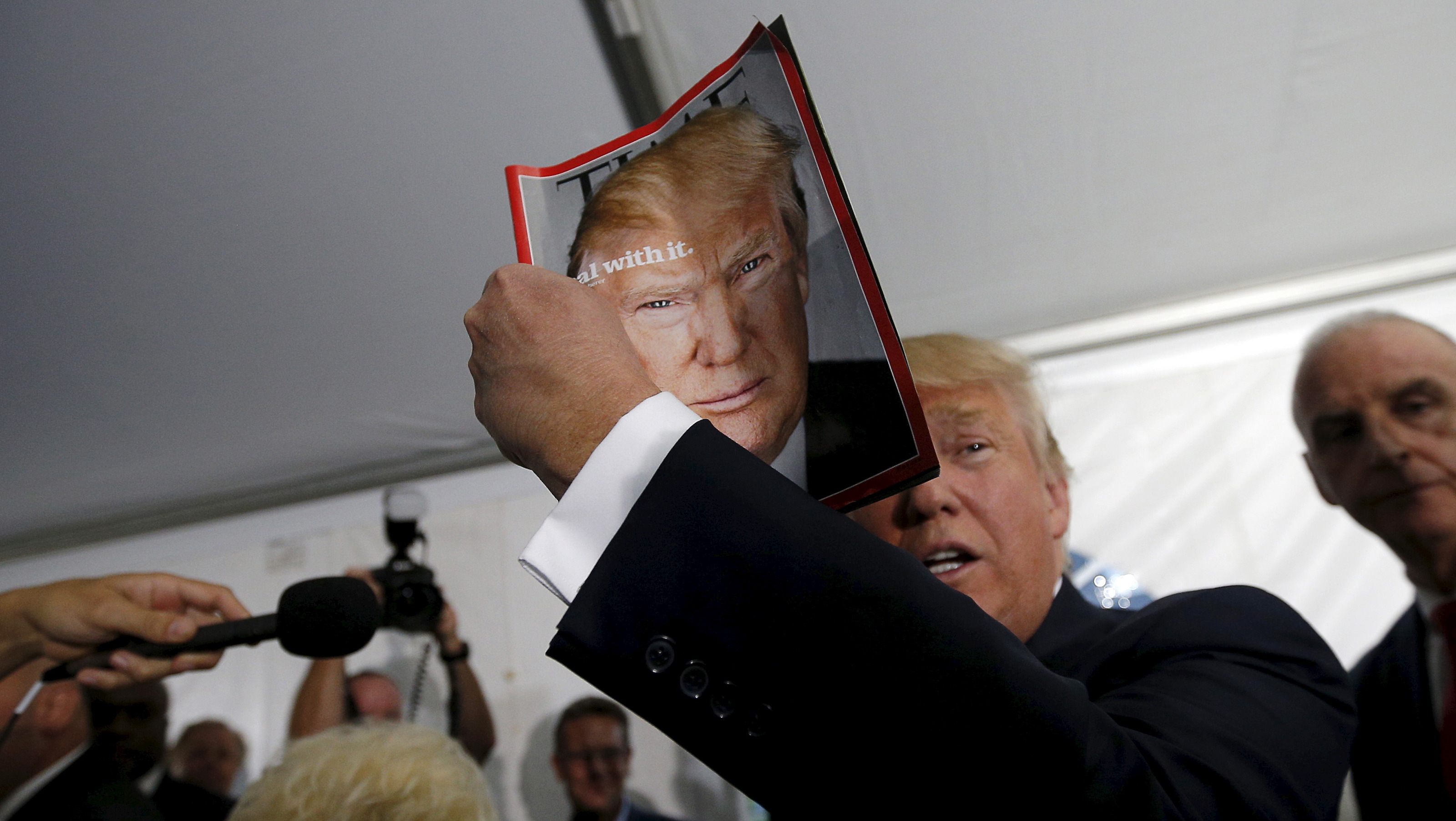 Donald Trump holding Time magazine