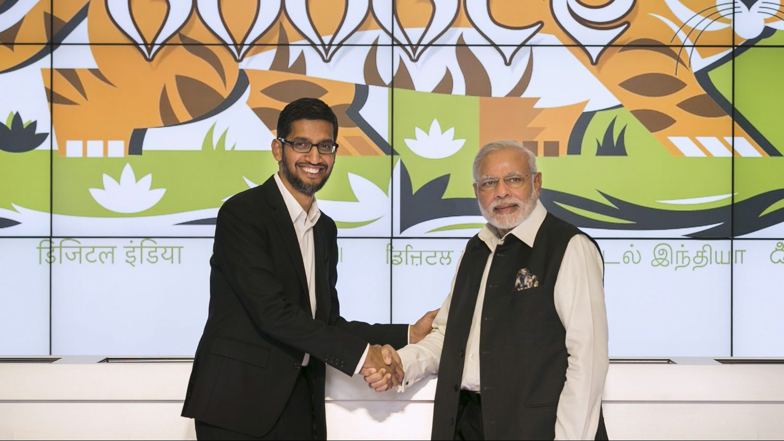 India's Prime Minister Narendra Modi (R) shakes hands with Google CEO Sundar Pichai at the Google campus in Mountain View, California September 27, 2015.