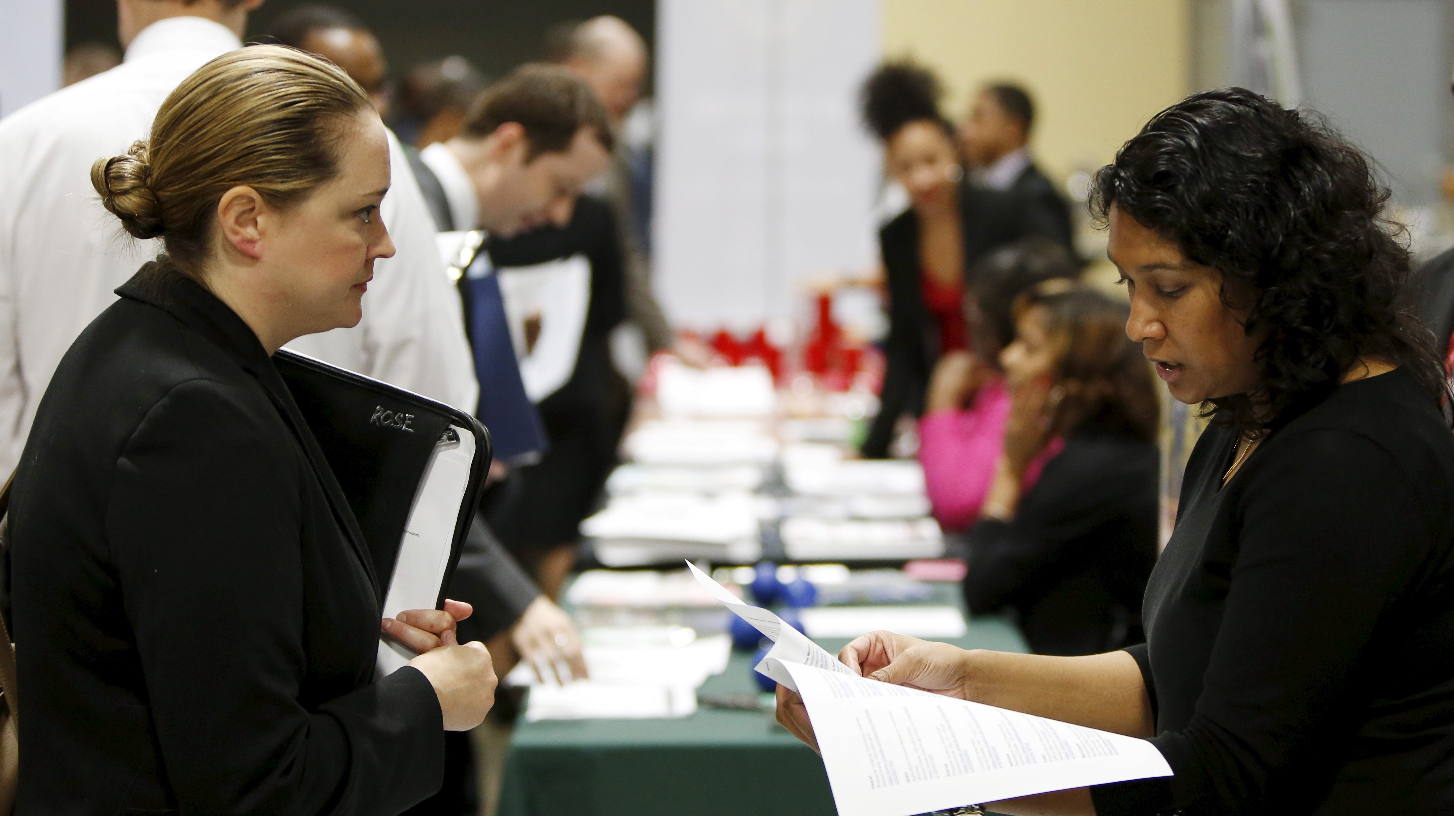 """Moushumi Paul (R) of the USDA interviews job applicant Sherry Rose (L) at a U.S. Chamber of Commerce Foundation """"Hiring Our Heroes"""" military job fair in Washington January 8, 2016."""