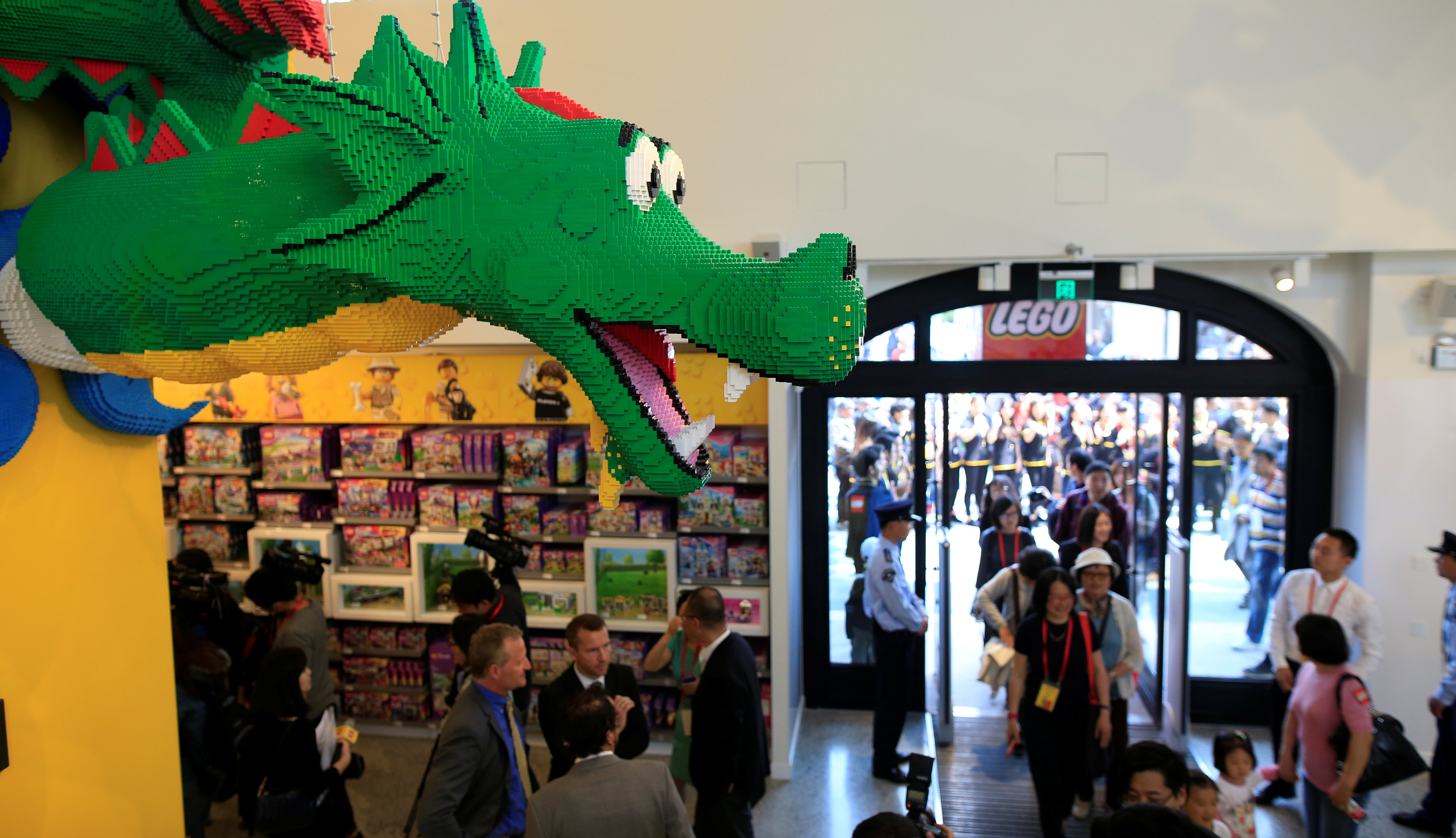 People visit a Lego store during its opening ceremony, the company's largest retail store in the world, near the Shanghai Disney Resort in Shanghai, China, May 11, 2016.  REUTERS/Aly Song - RTX2DSNU