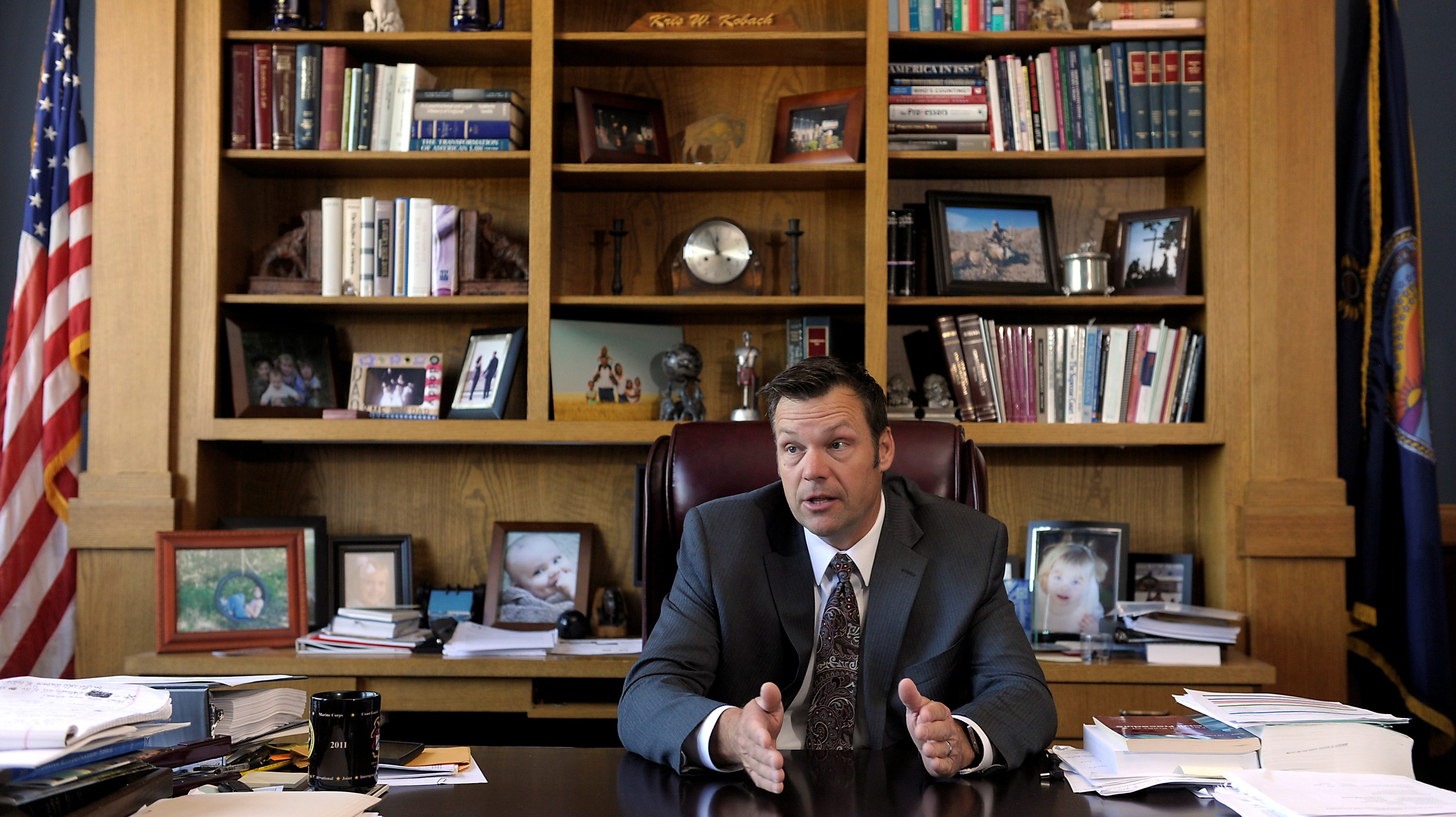 Kansas Secretary of State Kris Kobach talks about the Kansas voter ID law that he pushed to combat what he believes to be rampant voter fraud in the United States in his Topeka, Kansas, U.S., office May 12, 2016.