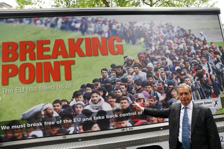 Leader of the United Kingdom Independence Party (UKIP) Nigel Farage poses during a media launch for an EU referendum poster in London, Britain June 16, 2016.