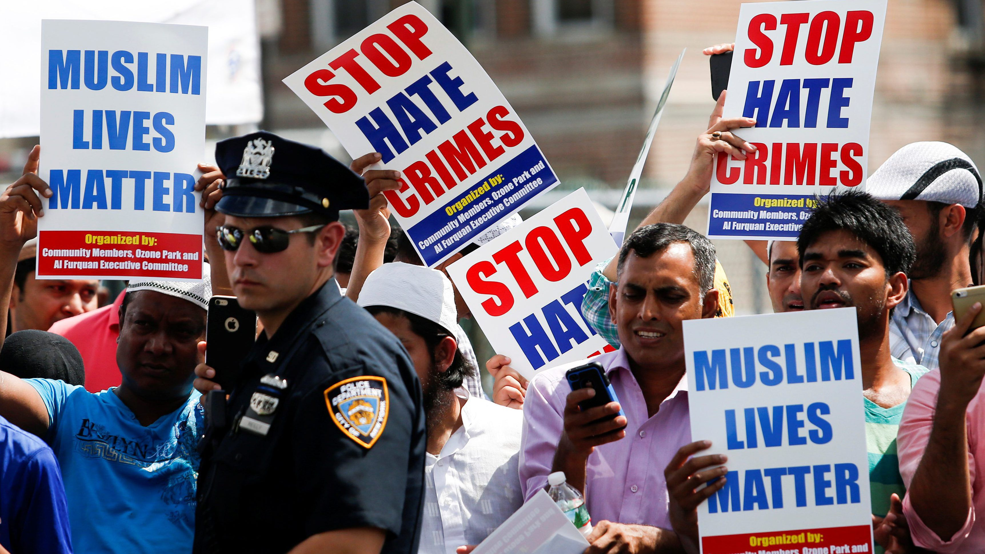 Community members take part in a protest to demand stop hate crime during the funeral service of Imam Maulama Akonjee, and Thara Uddin in the Queens borough of New York City, August 15, 2016.