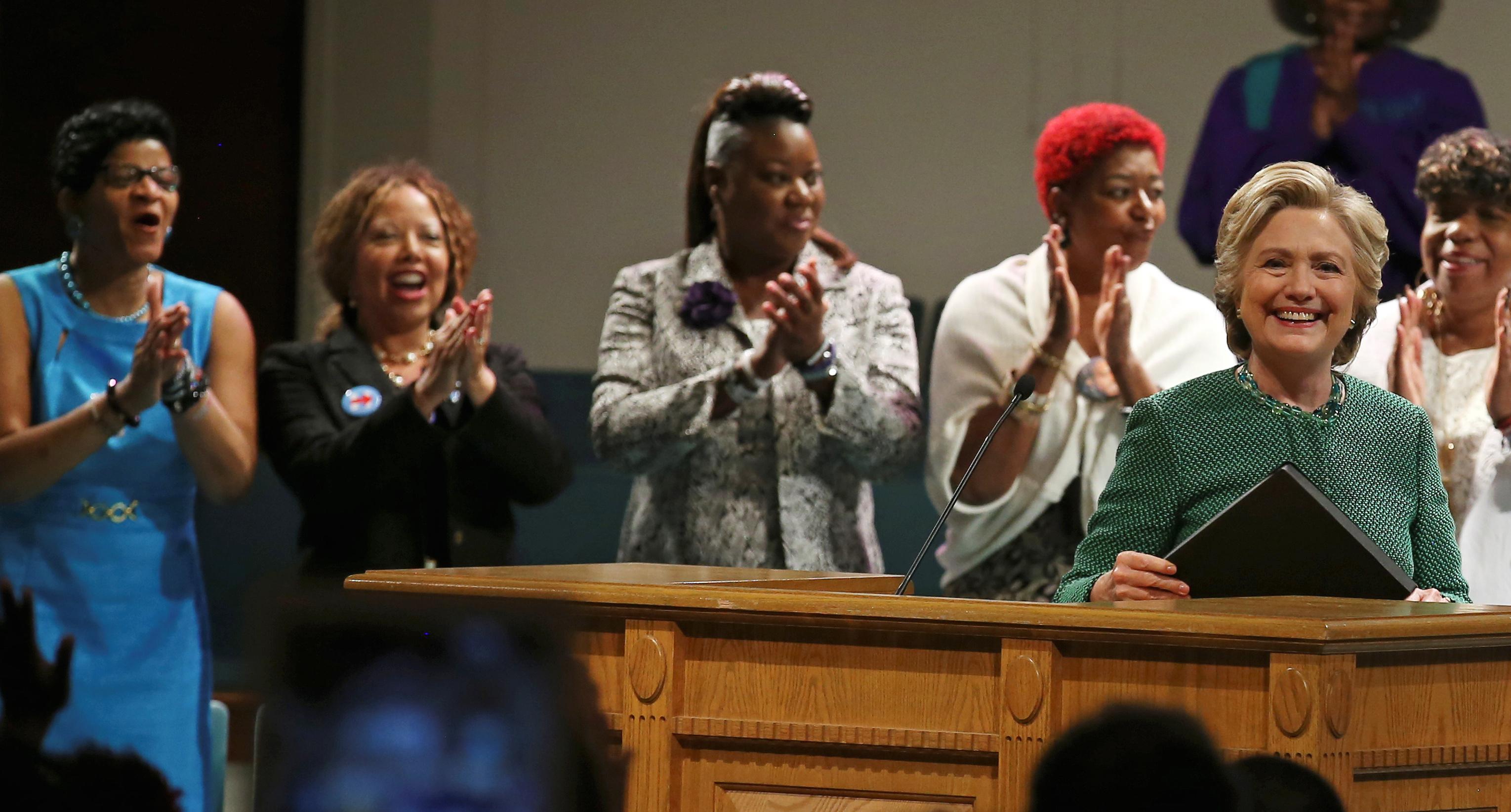 "U.S. Democratic presidential nominee Hillary Clinton speaks at a Sunday service at Union Baptist Church accompanied by ""Mothers of the Movement,"" a group of women who have lost their children in a series of police shootings which galvanized the ""Black Lives Matter"" movement, in Durham, North Carolina, U.S., October 23, 2016."