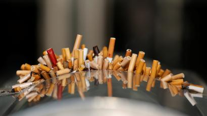 Extinguished cigarettes are seen in an ashtray at Shanghai Railway Station, China, December 23, 2013.