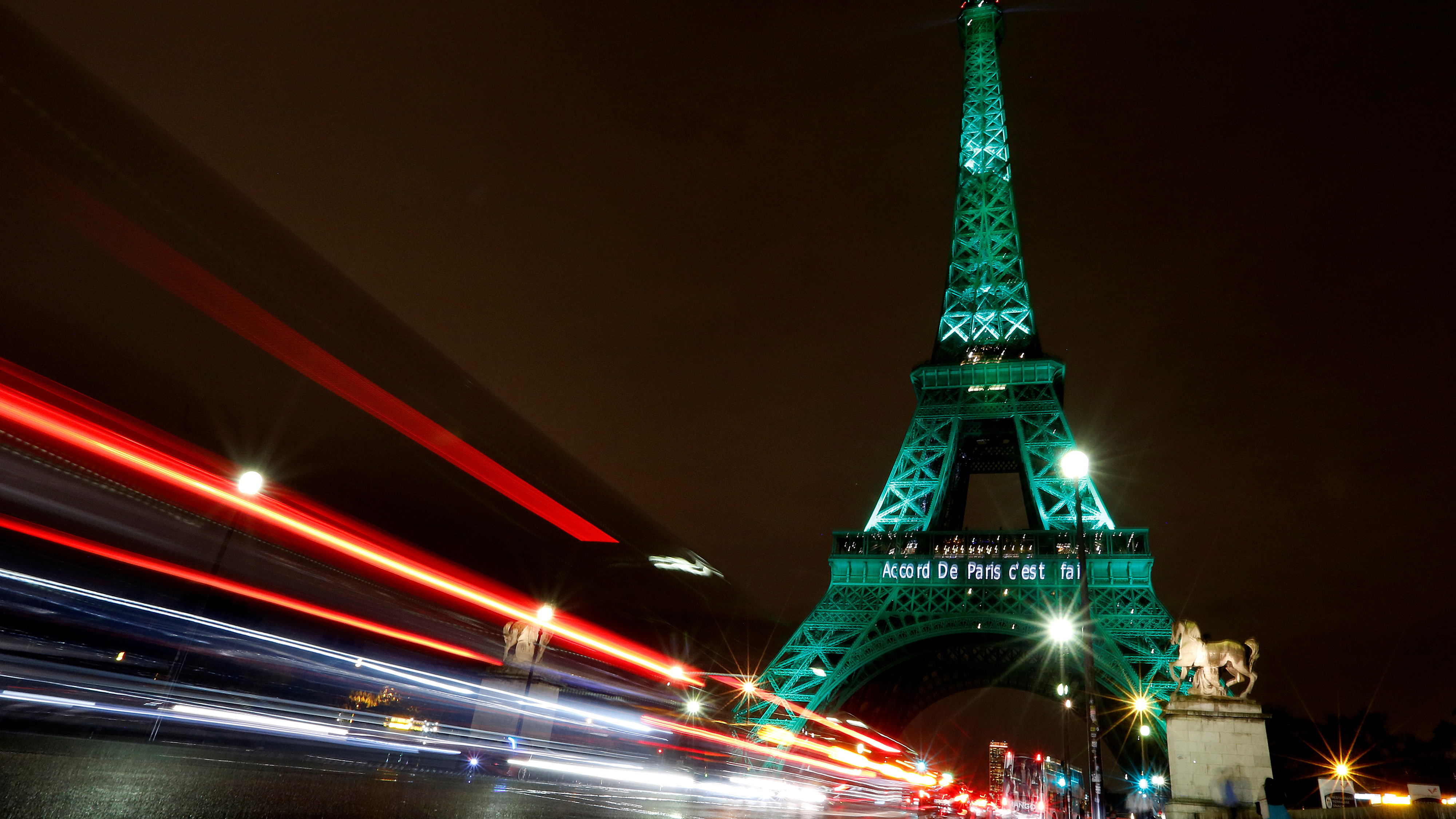 "The Eiffel tower is illuminated in green with the words ""Paris Agreement is Done"", to celebrate the Paris U.N. COP21 Climate Change agreement in Paris, France, November 4, 2016. Reuters/Jacky Naegelen - RTX2RZ42"