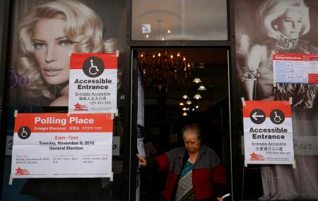 A voter leaves Daisy's Hair Studio after casting her ballot in the U.S. presidential election in Chicago, Illinois, U.S., November 8, 2016. REUTERS/Jim Young - RTX2SJYO