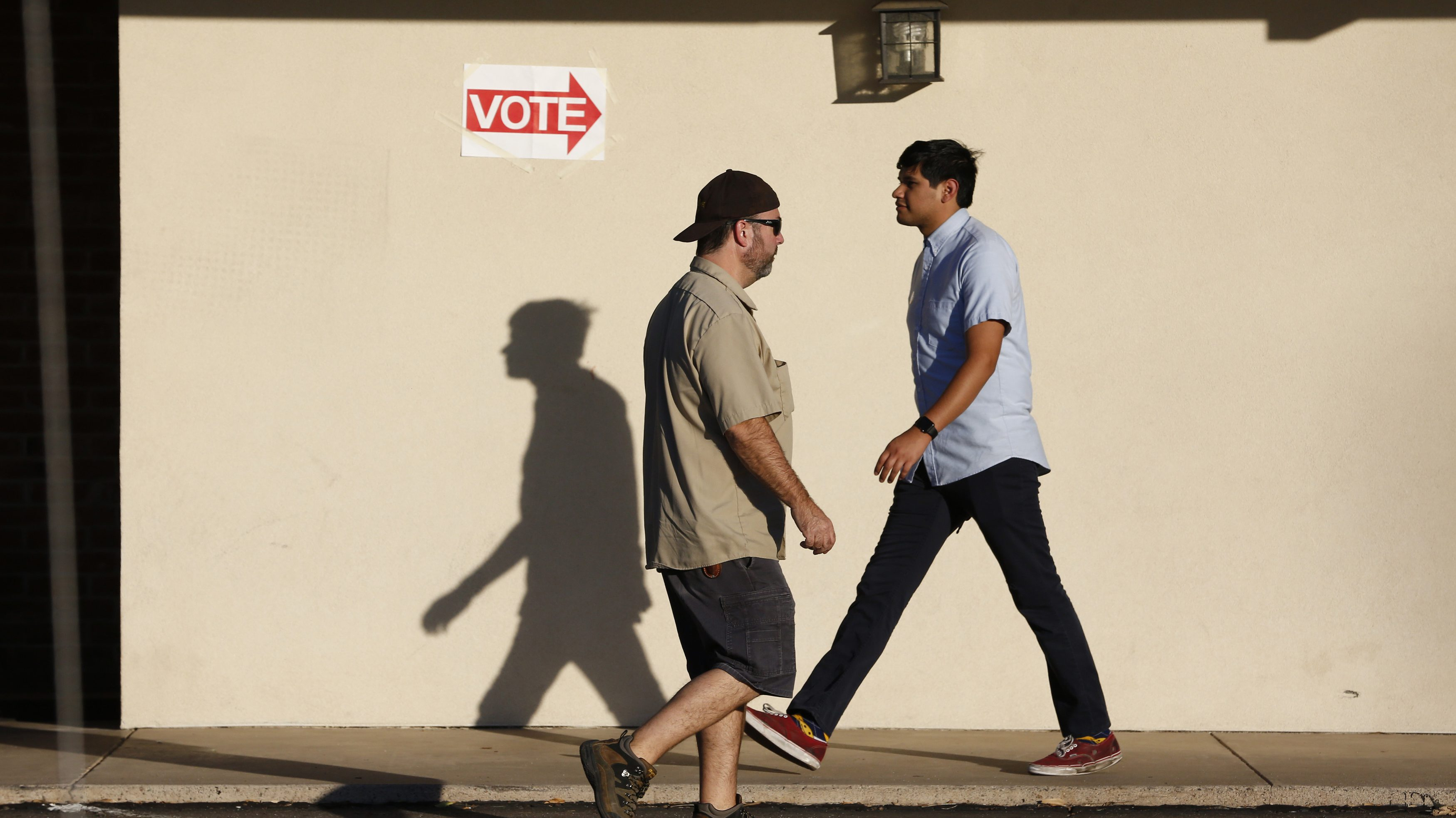 People come and go at a polling site during the U.S. presidential election in Phoenix, Arizona, U.S., November 8, 2016. REUTERS/Nancy Wiechec