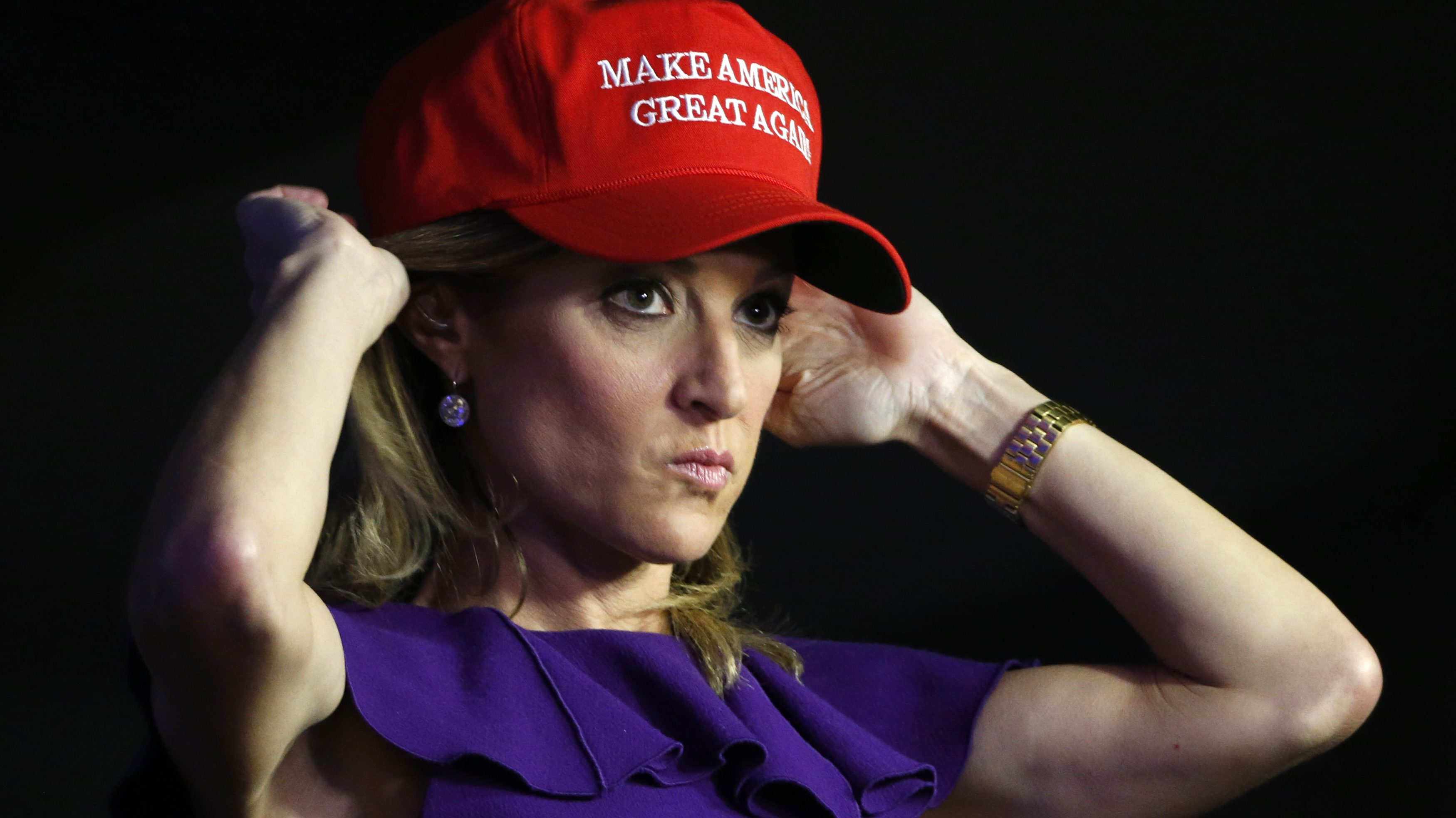 A Trump supporter adjusts her hat as she waits at Republican U.S. presidential nominee Donald Trump's election night rally in New York