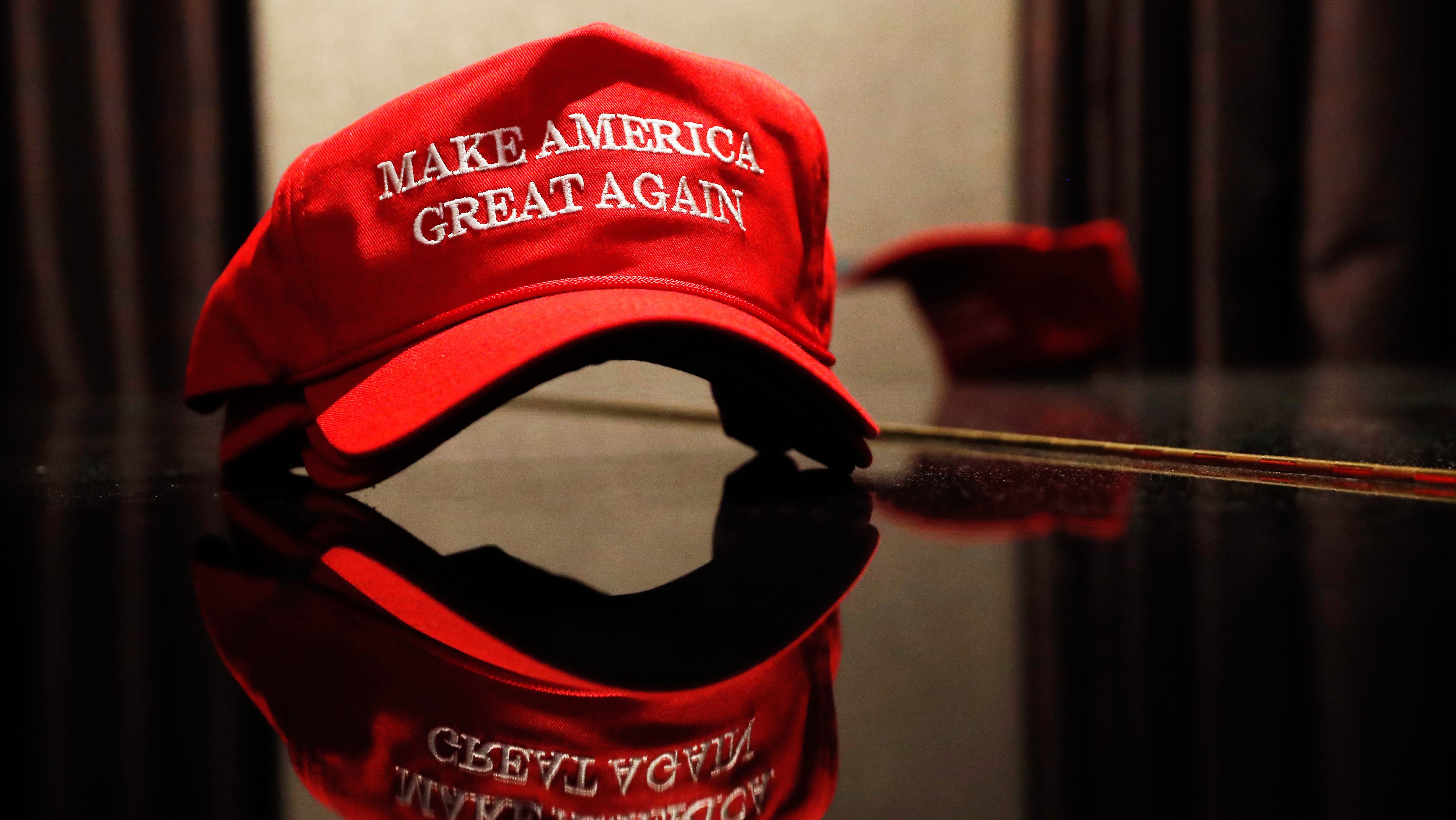 A Trump hat sits on a table outside of the rally for Republican U.S. presidential nominee Donald Trump in New York City, New York, U.S. November 8, 2016. REUTERS/Andrew Kelly  - RTX2SNXM