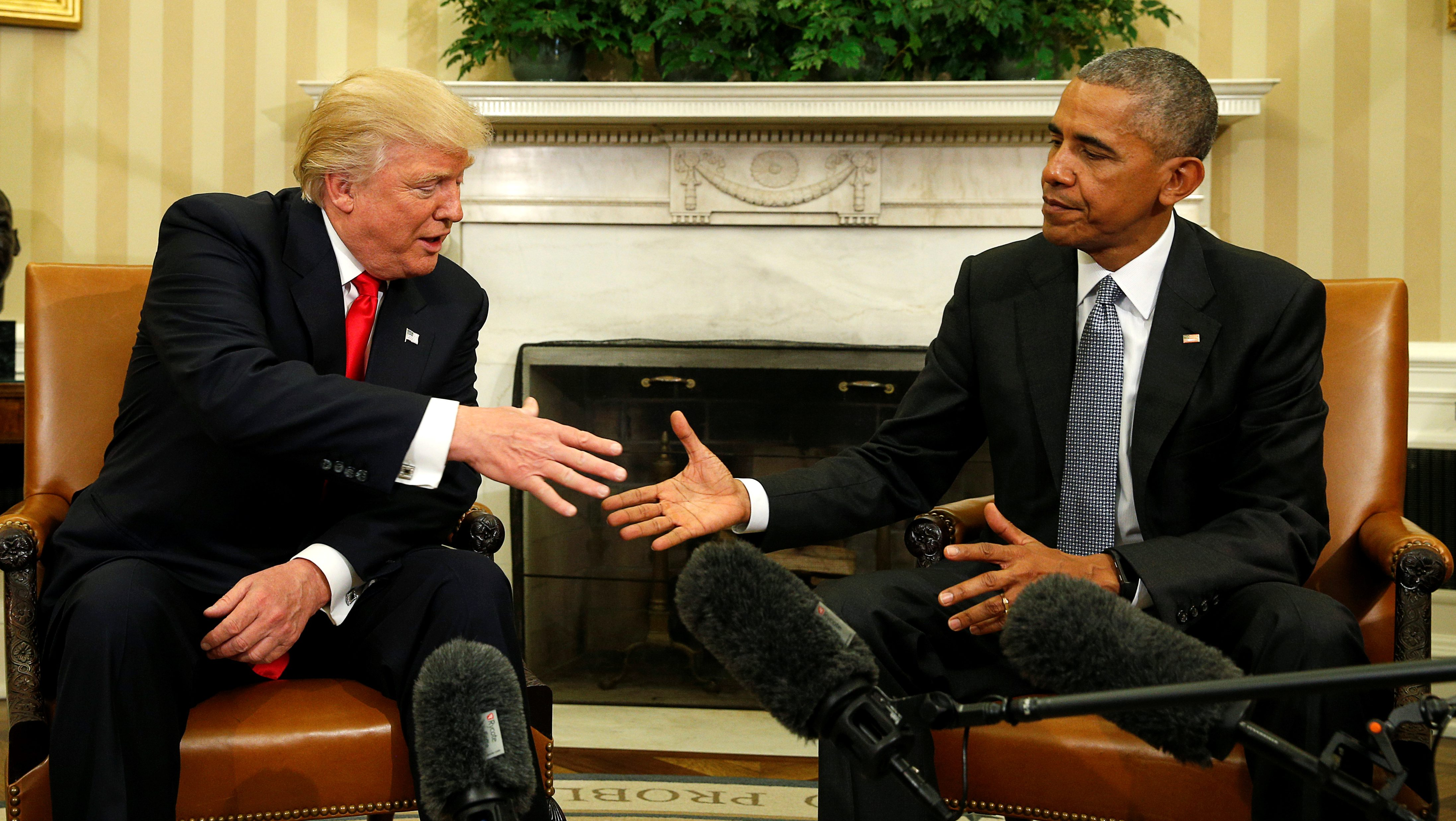 US President Barack Obama meets with President-elect Donald Trump in the Oval Office of the White House in Washington November 10,